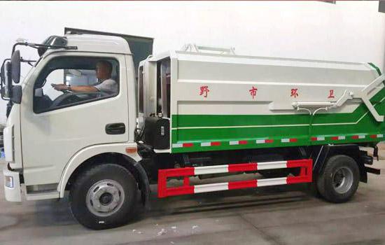 东风多利卡侧装挂桶垃圾车(国五)------6方-东风多利卡侧装挂桶垃圾车(国五)------6方